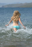 Young Girl Running to the Water Stock Image