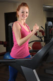 Young girl running at treadmill in gym Royalty Free Stock Photos