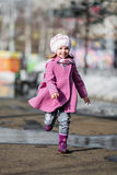 Young girl running at walkway Stock Image
