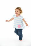 Young Girl Running In WhiteStudio Stock Photography