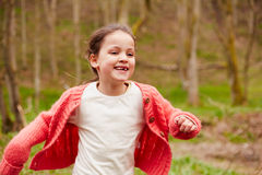 Young Girl Running Through Woodland Stock Photography