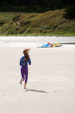 Young girl runs at the beach Royalty Free Stock Images