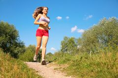 Young girl runs in forest. Summer Royalty Free Stock Image