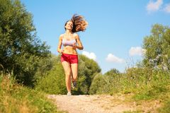 Young girl runs in forest Royalty Free Stock Photos