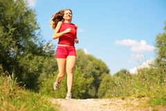 Young girl runs in forest Royalty Free Stock Photography