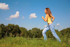 Young girl runs in park Stock Photography