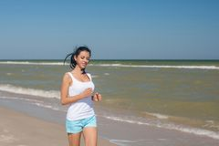 Young girl runs on the sea Royalty Free Stock Images