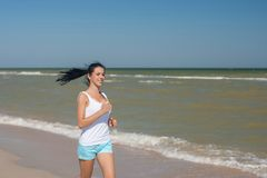 Young girl runs on the sea Stock Images