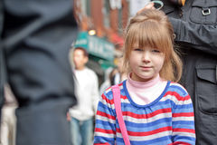 Young girl's face in crowd Royalty Free Stock Images