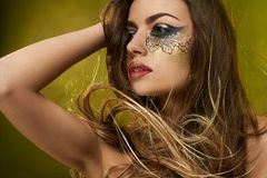 Young girl s face with fantastic make-up. royalty free stock photo