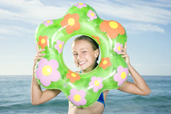 A young girl's face seen through a rubber ring Royalty Free Stock Image