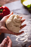 Young girl`s hand knead the dough Royalty Free Stock Photography