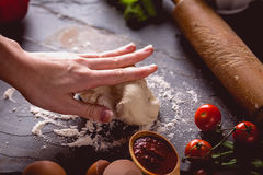 Young girl`s hand knead the dough Stock Photos