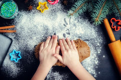 Young girl`s hands kneading dough Royalty Free Stock Photo