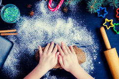 Young girl`s hands kneading dough Royalty Free Stock Photography