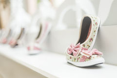 Young girl's shoes in children's footwear fashion shop Stock Photography