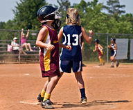 Young Girl's Softball. CUMMING, GA/USA - MAY 21:  Unidentified young girls running and fielding the ball during a softball game, May 21, 2010 in Forsyth County Royalty Free Stock Image