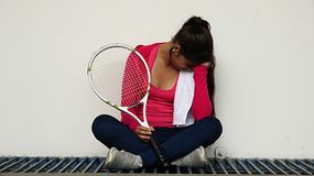 Young Girl Sad Athlete. A young hispanic female teen Royalty Free Stock Photo
