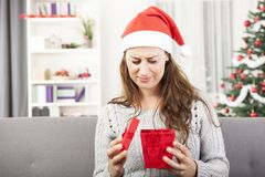 Young girl is sad about christmas gift Royalty Free Stock Photography