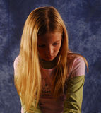 Young girl sad looking down. Young girl sad and looking down at that floor Stock Images