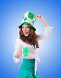 Young girl in saint patrick celebration concept Stock Photos