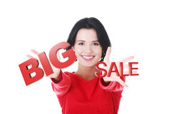 Young girl with SALE sign Royalty Free Stock Photos