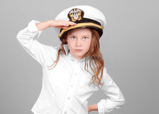 Young Girl Saluting in Uniform Royalty Free Stock Image
