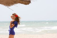 Young girl on sand beach Royalty Free Stock Photography