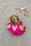 Young Girl in the Sand Stock Image