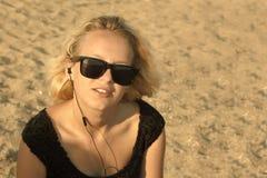 Young girl on the sandy beach Stock Photos