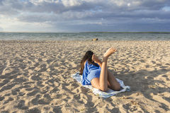 Young Girl on a sandy beach Stock Photography