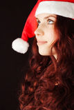 Young girl in Santa Claus hat Stock Image