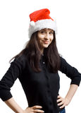 Young girl in a Santa Claus hat Stock Images