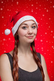 Young girl in Santa Claus hat Royalty Free Stock Image