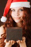 Young girl in santa claus hat Royalty Free Stock Photography