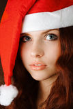 Young girl in santa claus hat Stock Photo