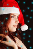 Young girl in santa claus hat Stock Photos
