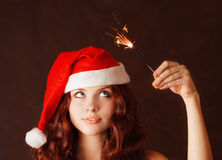 Young girl in santa claus hat Royalty Free Stock Images