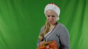 Young girl  in santa claus hat with a gift. stock video footage