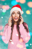 Young girl in Santa Claus hat Stock Photography