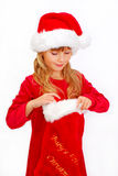 Young girl in santa cloth with christmas sock Royalty Free Stock Photos