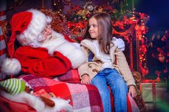 Young girl with santa stock photos