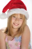 Young girl in a santa hat. Young girl smiling and wearing a santa hat Stock Images