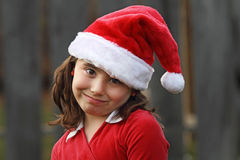 Young Girl in Santa Hat Royalty Free Stock Photos