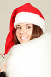 Young girl in santa hat Stock Images