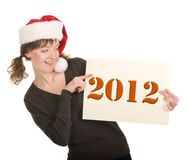 Young girl in Santa hat Stock Photos