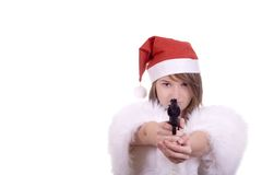 Young girl in Santa hat holding gun Royalty Free Stock Photos