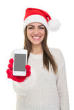 Young girl with Santa hat showing  smart phone screen Royalty Free Stock Photos