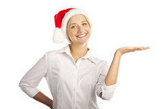 Young girl in a Santa hat in the studio on a white Royalty Free Stock Images