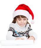 Young girl in Santa hat writes letter to Santa. isolated on whit Stock Photography